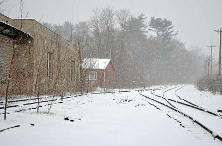 John Berry/Register Citizen Snow falls Friday afternoon on the tracks that run through Torrington.