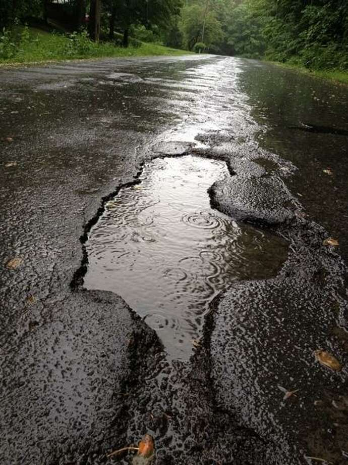 JOHN HAEGER @ONEIDAPHOTO ON TWITTER/ONEIDA DAILY DISPATCH Potholes on Brewer Road in the city of Oneida on Thursday, June 13, 2013.