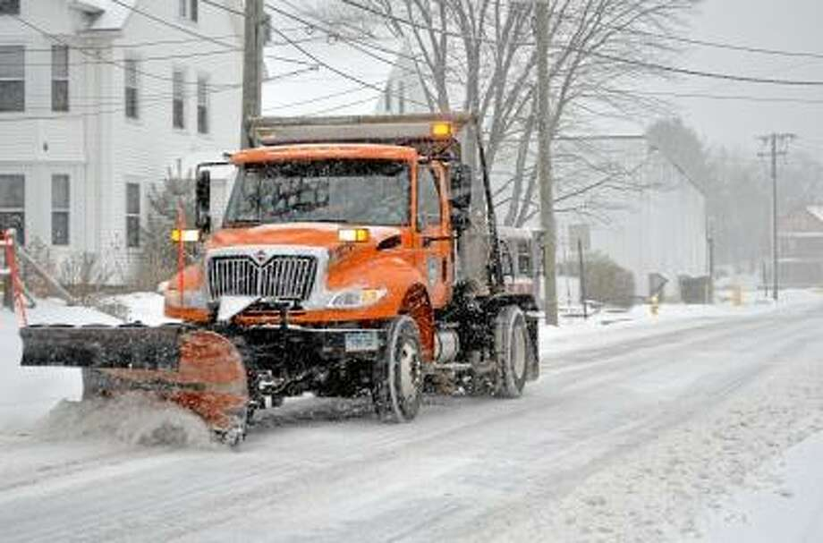 The city plow drivers were doing their best to keep the roads in Torrington clear Friday afternoon as the begining of the weekend snow storm hit. John Berry/Register Citizen.