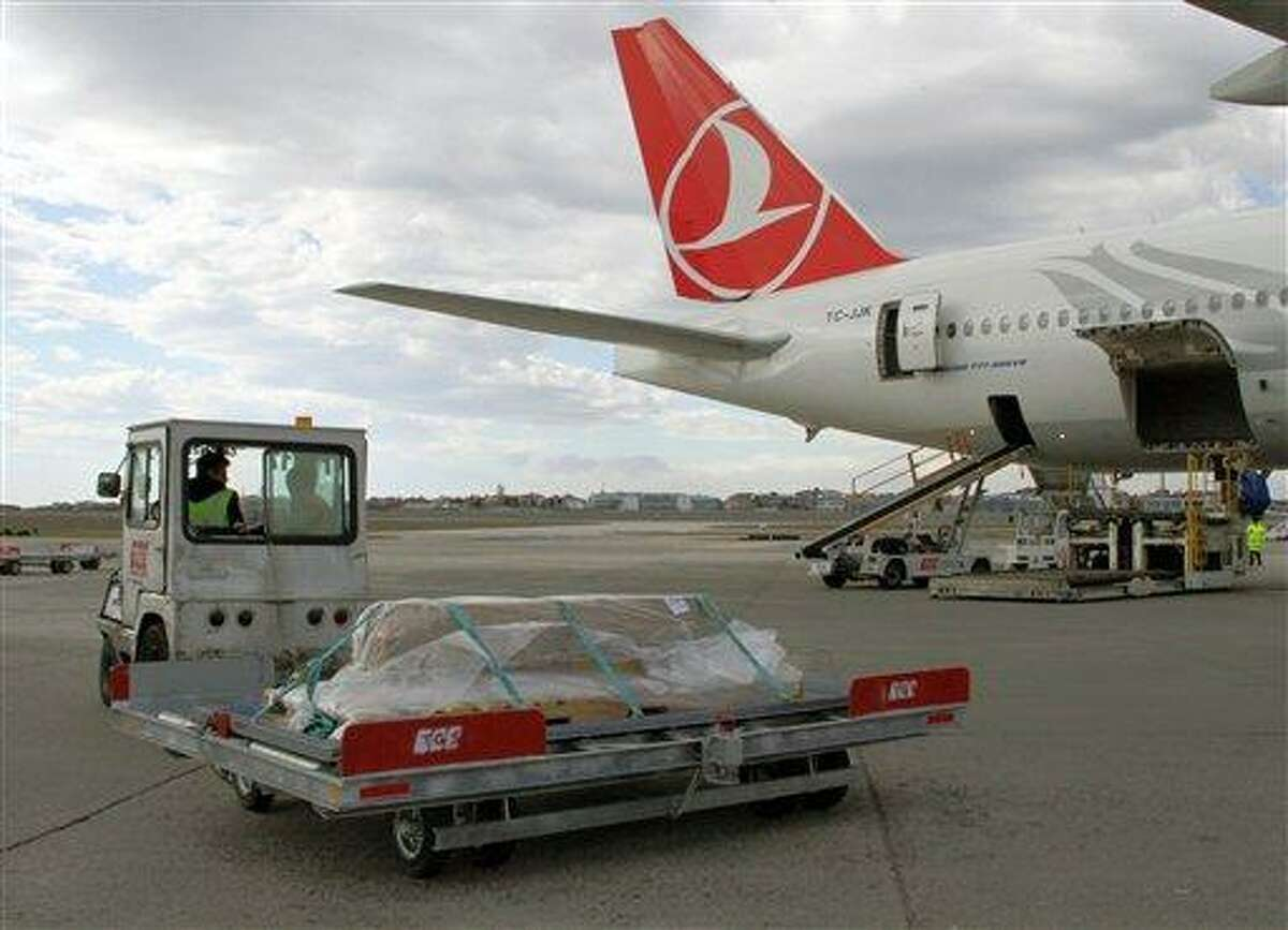 Turkish airport ground service workers load a casket carrying the remains of New York City woman Sarai Sierra, 33, found dead while on a solo vacation in Istanbul, into a plane bound for New York at the Ataturk Airport in Istanbul, Turkey, Thursday, Feb. 7, 2013.(AP Photo/IHA) TURKEY OUT - INTERNET OUT