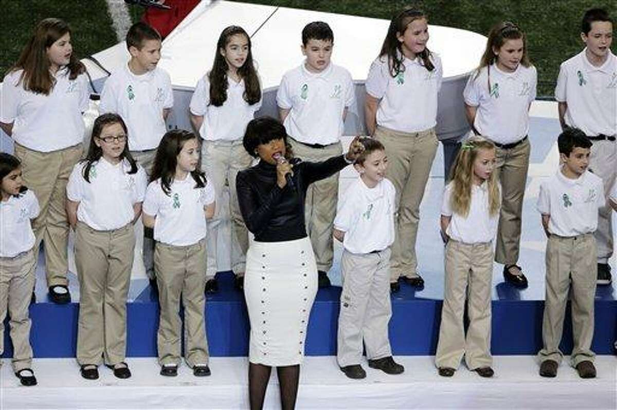FILE - In this Feb. 3, 2013 file photo, Jennifer Hudson performs with students from Sandy Hook Elementary School singing