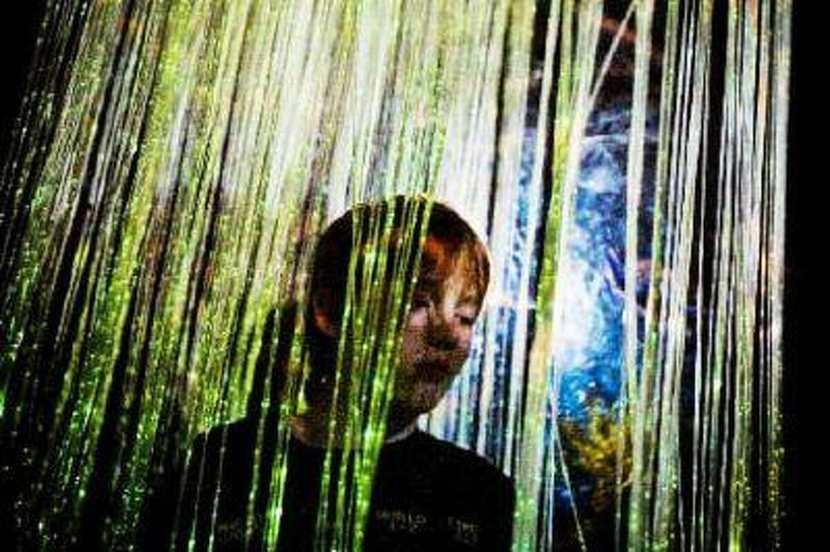 Scott Monzi, 13, sits in the sensory room at Amazing Kids Club in Hanover in this photo from 2009. Amazing Kids Club helps children with autism and other disabilities and the sensory room helps calm down the kids that may be too easily overwhelmed by many distractions. (THE EVENING SUN -- FILE)