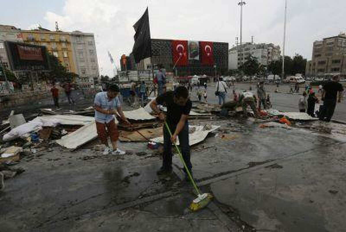 Protesters clean the entrance to Gezi park in Istanbul's Taksim square June 15, 2013.