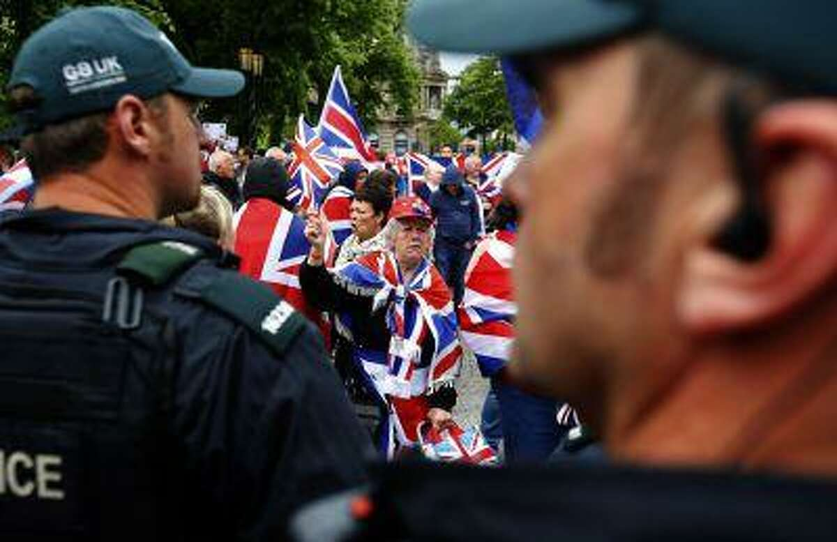 REFILE - CORRECTING GRAMMAR IN FIRST SENTENCE Loyalist demonstrators take part in a protest in Belfast, against the upcoming G8 summit to be held near Enniskillen, June 15, 2013.