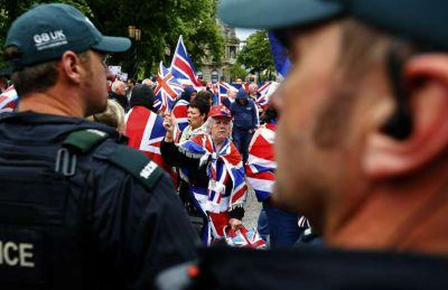 REFILE - CORRECTING GRAMMAR IN FIRST SENTENCE Loyalist demonstrators take part in a protest in Belfast, against the upcoming G8 summit to be held near Enniskillen, June 15, 2013. Photo: REUTERS / X00380