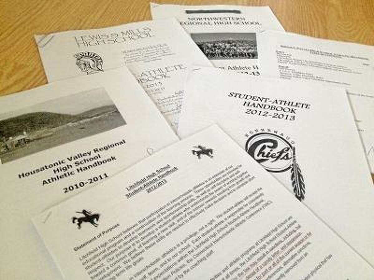 Some of the handbooks from schools in the Register Citizen area. Jessica Glenza/Register Citizen