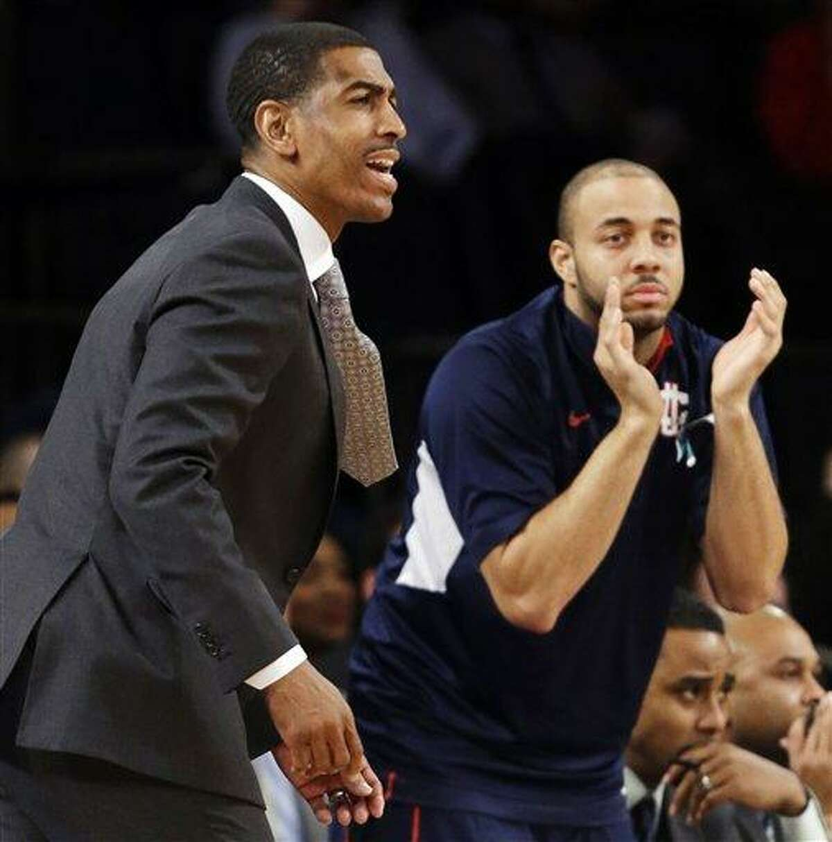 Connecticut head coach Kevin Ollie, left, reacts in the first half of their NCAA college basketball game against St. John's at Madison Square Garden in New York, Wednesday, Feb. 6, 2013. St. John's won 71-65. (AP Photo/Kathy Willens)