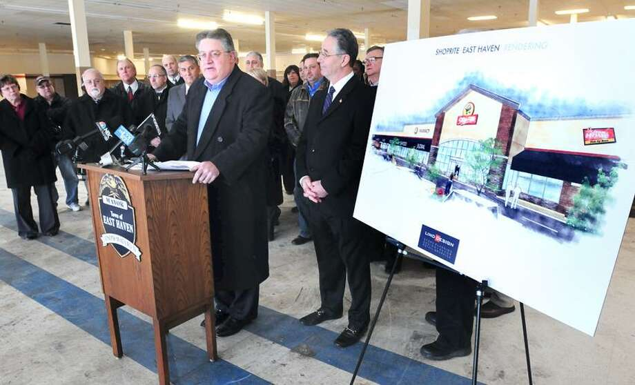 Harry Garafalo (at podium), President of Milford Markets, speaks during the announcement that a ShopRite will be opening in the former A&P food store on Foxon Rd. in East Haven on 2/7/2013.  At center right is East Haven Mayor Joseph Maturo, Jr.Photo by Arnold Gold/New Haven Register   AG0483A