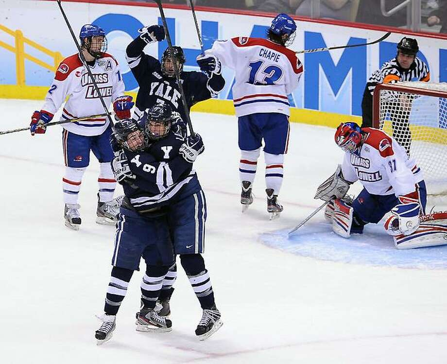 """Pittsburg, PA--  Yale Celebrates their second goal in the first period against UMASS- Lowell.  Photo-Peter Casolino/Register <a href=""""mailto:pcasolino@newhavenregister.com"""">pcasolino@newhavenregister.com</a>"""