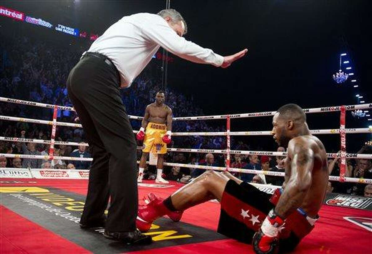 Chad Dawson from the United States is counted out by the referee after being knocked out by Adonis Stevenson from Canada during their WBC light-heavyweight championship bout in Montreal, Saturday, June 8, 2013. (AP Photo/The Canadian Press, Graham Hughes)