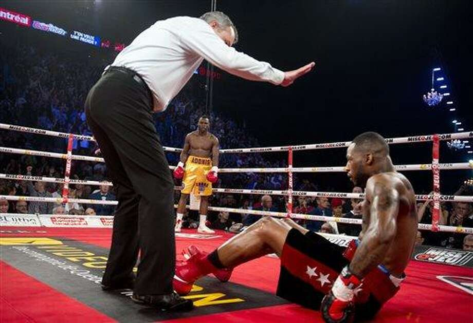 Chad Dawson from the United States is counted out by the referee after being knocked out by Adonis Stevenson from Canada during their WBC light-heavyweight championship bout in Montreal, Saturday, June 8, 2013. (AP Photo/The Canadian Press, Graham Hughes) Photo: AP / CP