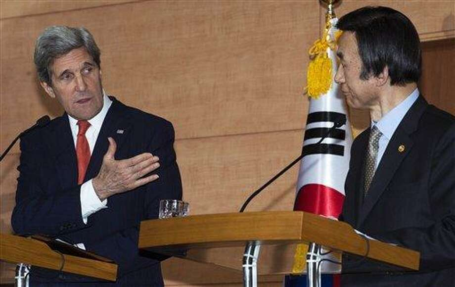 U.S. Secretary of State John Kerry, left, and South Korea Foreign Minister Yun Byung-se attend a joint press conference at the Foreign Ministry in Seoul, Friday, April 12, 2013. Kerry is making his first-ever visit to Seoul amid strong suspicion that North Korea may soon test a mid-range missile. (AP Photo/Paul Richards, Pool) Photo: AP / AFP POOL