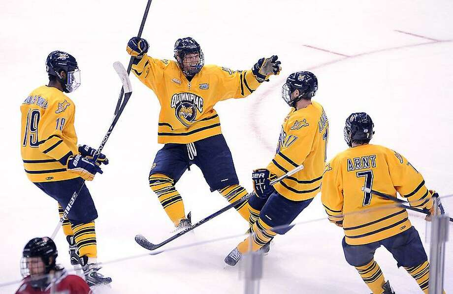 """Pittsburg, PA--  Quinnipiac celebrates their third goal in the first period against St. Cloud.  Photo-Peter Casolino/Register <a href=""""mailto:pcasolino@newhavenregister.com"""">pcasolino@newhavenregister.com</a>"""