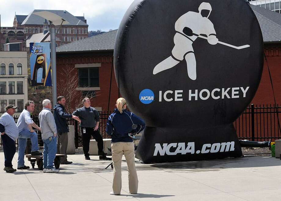 "Pittsburg, PA-- Officials inflate an NCAA balloon outside the Consol Center as they prepare for the Quinnipiac Yale game on Saturday.  Photo-Peter Casolino/Register <a href=""mailto:pcasolino@newhavenregister.com"">pcasolino@newhavenregister.com</a>"