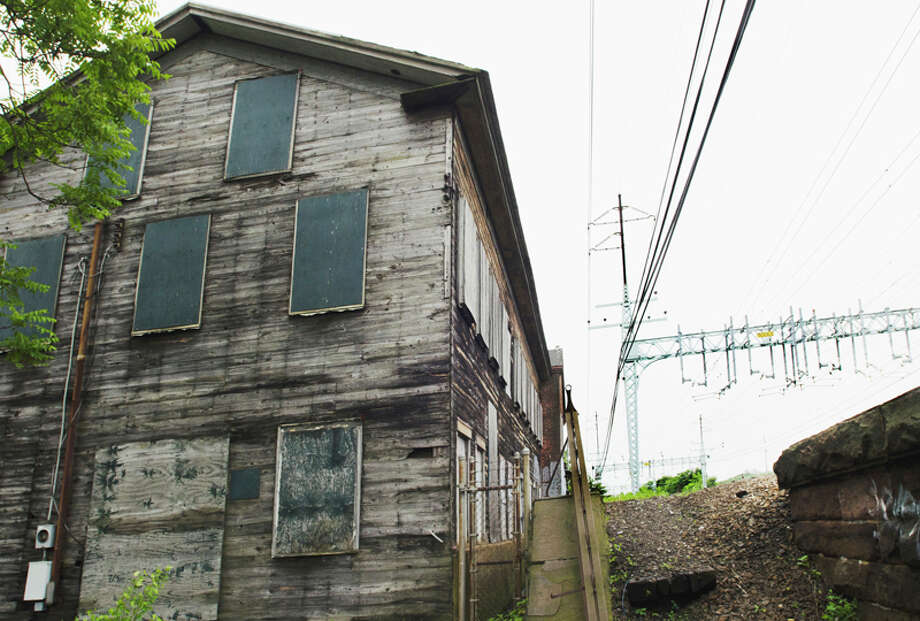 The city of West Haven is putting together a bid package for the demolition of the old buckle factory, shown Thursday at 742 Washington Ave. Melanie Stengel/Register