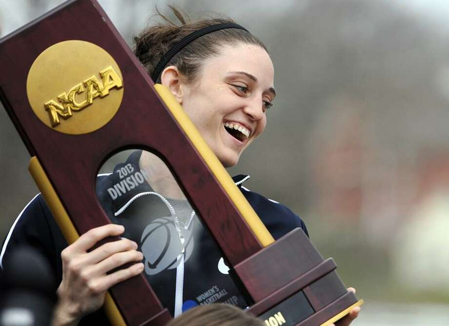 Connecticut's Kelly Faris holds the championship trophy during a parade through campus honoring the team's win in the women's NCAA Final Four college basketball championship in Storrs, Conn., Wednesday, April 10, 2013. (AP Photo/Jessica Hill) Photo: AP / AP2013