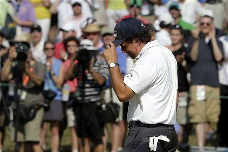Phil Mickelson reacts after a putt on the sixth hole during the third round of the U.S. Open golf tournament at Merion Golf Club, Saturday, June 15, 2013, in Ardmore, Pa. (AP Photo/Charlie Riedel) Photo: AP / AP