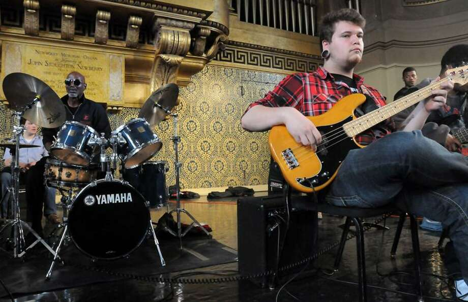 Woolsey Hall, Yale Univ.: T.S. Monk, jazz great Thelonius Monk's son, left, held a teaching performance on stage with mostly Cooperative Arts High School (New Haven) including Joe Zombrowski of East Haven right. The audience was children from the greater New Haven area.   Mara Lavitt/New Haven Register4/11/13