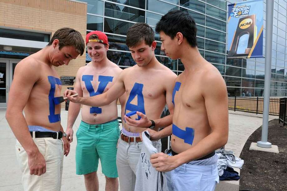 "Pittsburg, PA--  Yale Sophomores, left to right; Tom Morley, Dalton Carr, Zac Mohring and Peter Zang get painted up for the big game against UMASS Lowell.  Photo-Peter Casolino/Register <a href=""mailto:pcasolino@newhavenregister.com"">pcasolino@newhavenregister.com</a>"