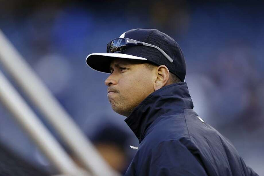 New York Yankees' Alex Rodriguez stands behind the batting cage before a baseball game against the Boston Red Sox at Yankee Stadium in New York, Wednesday, April 3, 2013. (AP Photo/Kathy Willens) Photo: AP / AP