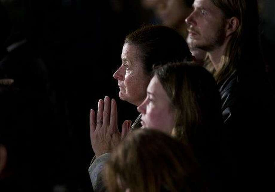 Residents look on during an interfaith vigil for the victims of the Sandy Hook Elementary School shooting on Sunday, Dec. 16, 2012, at Newtown High School in Newtown, Conn. A gunman walked into the elementary school Friday and opened fire, killing 26 people, including 20 children. President Barack Obama is schedule to speak during the vigil.  (AP Photo/ Evan Vucci) Photo: AP / AP