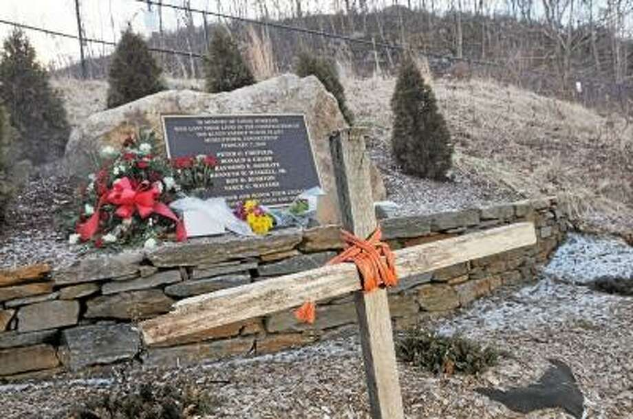 Catherine Avalone/The Middletown Press A memorial made using a makeshift cross and a bronze plaque set in stone has been set up about a mile east of the Kleen Energy Power Plant on River Road in Middletown. Thursday marked the three year anniversary of the explosion that killed six workers, Peter C. Chepulis, Ronald J. Crabb, Raymond E. Dobratz, Kenneth W. Haskell, Jr., Roy D. Rushton and Vance C. Walters during the construction of the plant. / TheMiddletownPress