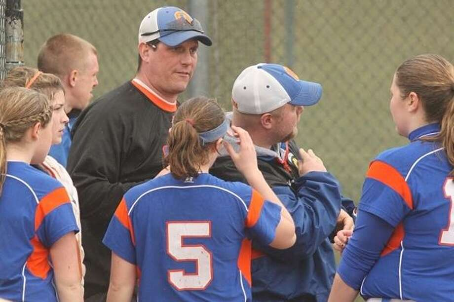 PHOTO BY JOHN HAEGER @ONEIDAPHOTO ON TWITTER - ONEIDA DAILY DISPATCH Oneida coaches Mike Curro and Jason Fuller talk to the team during a game against Herkimer.