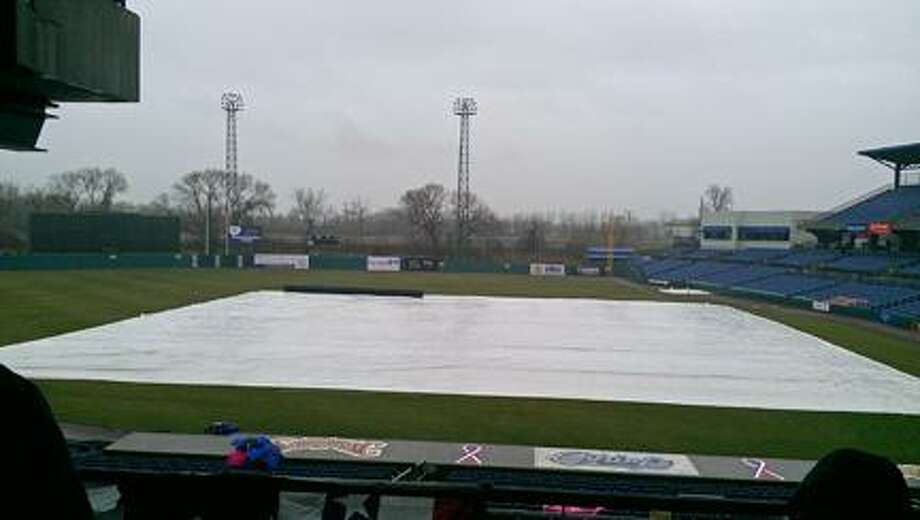 KYLE MENNIG/ONEIDA DAILY DISPATCH The tarp covers the field at NBT Bank Stadium during a rain delay before the Syracuse Chiefs' scheduled home opener on Friday, April 12, 2013. The game was rained out.