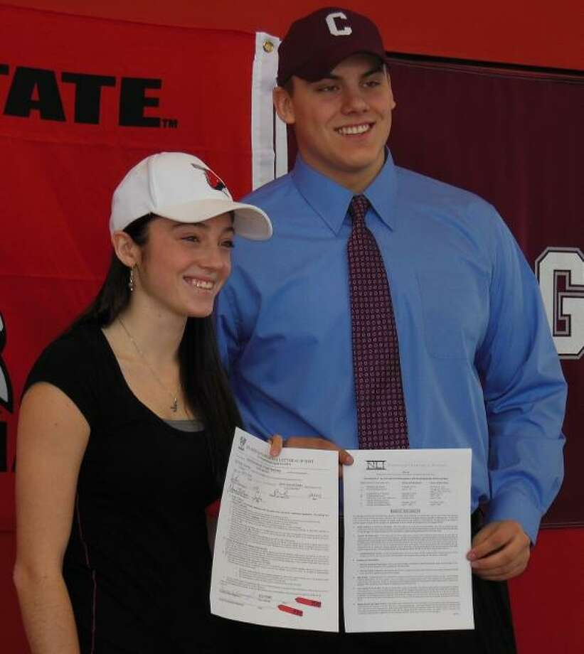 Submitted Photo VVS' Alexis Kavanaugh and Brett Field stand with their signed National Letters of Intent.