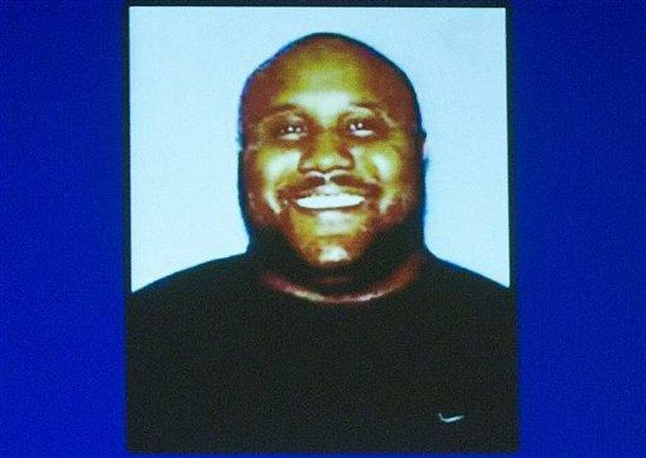 In this image provided by the Irvine, Calif., Police Department via The Orange County Register, former Los Angeles police officer Christopher Jordan Dorner is shown. Dorner is a suspect in the killings of Monica Quan and her fiance, Keith Lawrence, who were found shot to death in their car at a parking structure Sunday night. (AP Photo/Irvine Police Department via The Orange County Register) Photo: AP / Irvine Police Department via CAANR
