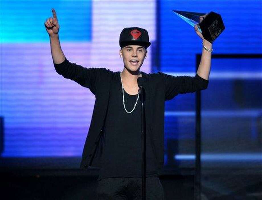 "FILE - In this Nov. 18, 2012 file photo, Justin Bieber accepts the award for favorite album - pop/rock for ""Believe"" at the 40th Anniversary American Music Awards, in Los Angeles.(Photo by John Shearer/Invision/AP, File) Photo: JOHN SHEARER/INVISION/AP / Invision"