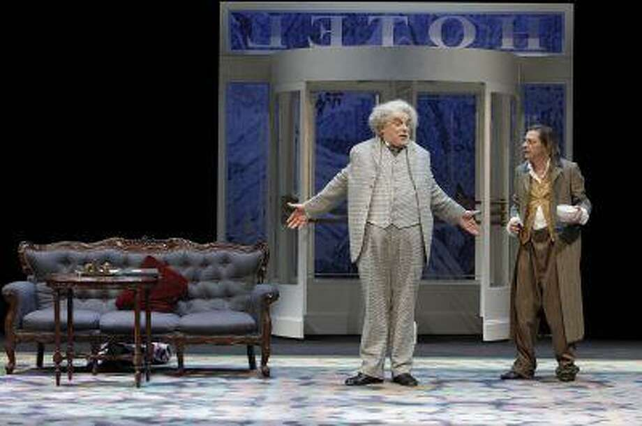 "Jacques Weber, left, and Jean-Damien Barbin as Monsieur Martin and his insolent valet Pionceux in ""Le Prix Martin"" by Eugene Labiche in Paris, France, in this handout photo taken on March 14, 2013. The farce runs at the Odeon Theater through May 5."