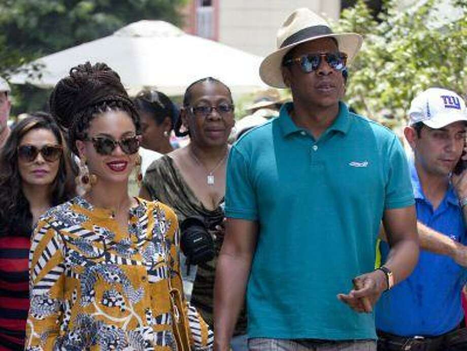 "FILE - This April 4, 2013 file photo shows married musicians Beyonce, left, and rapper Jay-Z as they tour Old Havana, Cuba. Jay-Z is addressing his recent trip to Cuba in a new song. The rapper released ""Open Letter"" Thursday, April 11, after two Florida Republicans questioned if the rapper's visit to Havana with wife Beyonce was officially licensed. (AP Photo/Ramon Espinosa, file) Photo: AP / AP"