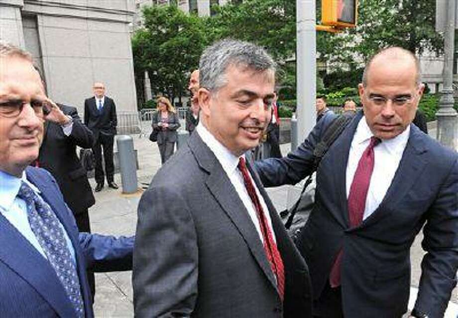 Eddy Cue, Apple's senior V.P. of Internet Software and Services exits Manhattan federal court following his testimony in the e-book pricing trial, Thursday, June 13, 2013, in New York. (AP Photo/Louis Lanzano) Photo: AP / FR77522 AP