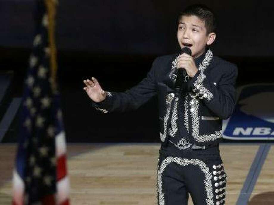 Sebastien De la Cruz sings the U.S. National Anthem before Game 4 of the NBA Finals basketball series between the San Antonio Spurs and the Miami Heat, Thursday, June 13, 2013, in San Antonio. (David J. Phillip/AP) Photo: AP / AP
