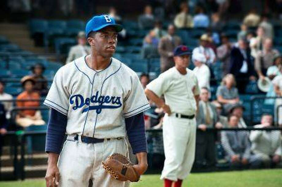 "This film image released by Warner Bros. Pictures shows Chadwick Boseman as Jackie Robinson in a scene from ""42."" The movie, about Robinson's, life, is bringing his inspiring story to a new generation. Fans young and old can find a number of places in Brooklyn connected to the baseball great. (AP Photo/Warner Bros. Pictures, D. Stevens) Photo: AP / Warner Bros. Pictures"