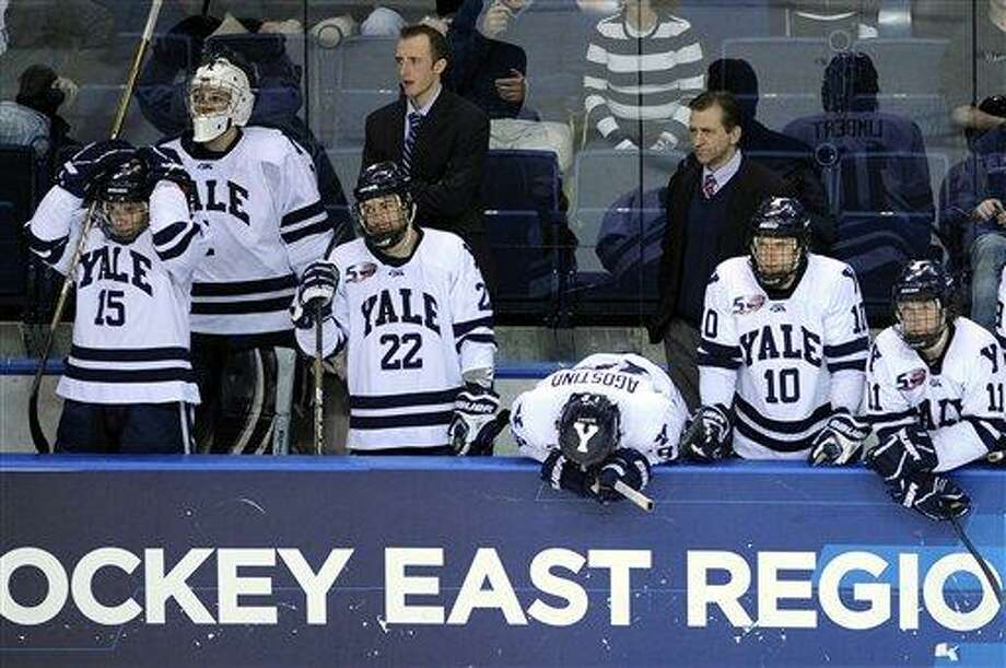The Yale bench reacts late in the third period of their 5-3 loss to Minnesota-Duluth in an East regional final game in the NCAA college hockey tournament in Bridgeport, Conn., on Saturday, March 26, 2011. (AP Photo/Fred Beckham) Photo: ASSOCIATED PRESS / AP2011