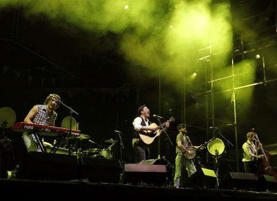 English folk rock band Mumford and Sons' Marcus Mumford (2nd L), Winston Marshall (2nd R), Ted Dwane (R) and Ben Lovett (L) perform on the main stage during the second day of the Coachella Valley Music & Arts Festival in Indio, California April 16, 2011. REUTERS/Mike Blake / X00030