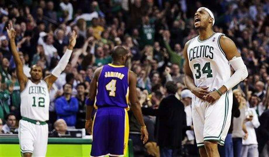 Boston Celtics forward Paul Pierce (34) celebrates a 3-pointer as guard Leandro Barbosa (12) reacts and Los Angeles Lakers forward Antawn Jamison (4) walks away during the fourth quarter of an NBA basketball game in Boston, Thursday, Feb. 7, 2013. Pierce scored 24 points as the Celtics won 116-95. (AP Photo/Charles Krupa) Photo: ASSOCIATED PRESS / AP2013