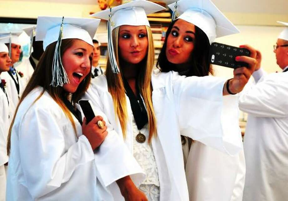 Peter Hvizdak Ñ Register Hamden Hall classmates Allie Rhian of Orange, left, Sofia Aschettino of Orange and Claire Brigham of Hamden, right,  take a photo together before the start of Hamden Hall Country Day School's 101st Commencement Exercise Friday, June 14, 2013 in Hamden, Conn. 56 students will graduate from the school. Photo: New Haven Register / ©Peter Hvizdak /  New Haven Register