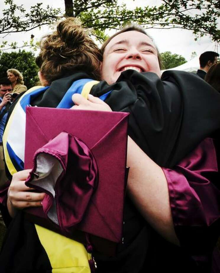 Melanie Stengel â?? Register     Hopkins Graduate, Uma Gould Dieffenbach, hugs Head Librarian, Faye Pendergast after the conclusion of Commencement ceremonie.