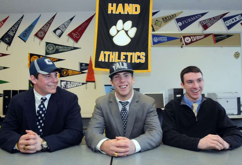 Three football players have signed or promised to attend three different schools: Matt Walsh, left will go to UConn, Peter Gerson center will go to Yale, and quarterback Brendan Bilcheck, right, will go to Bowdoin. Mara Lavitt/New Haven Register2/6/13