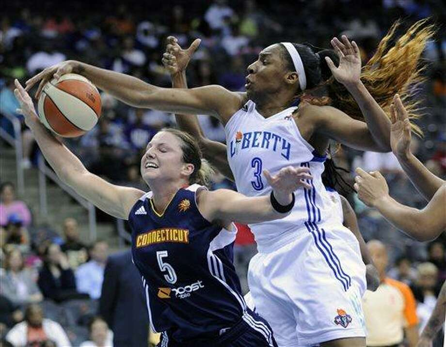 New York Liberty forward Kelsey Bone, right, blocks a shot by Connecticut Sun forward Kelsey Griffin during the second quarter of a WNBA basketball game on Friday, June 14, 2013, at Prudential Center in Newark, N.J. (AP Photo/Bill Kostroun) Photo: AP / FR51951 AP