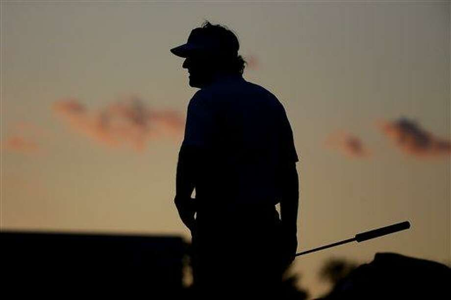 Phil Mickelson waits to putt on the 18th green during the second round of the U.S. Open golf tournament at Merion Golf Club, Friday, June 14, 2013, in Ardmore, Pa. (AP Photo/Morry Gash) Photo: AP / AP