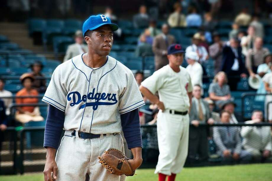 """D. Stevens/Warner Bros. Pictures photo: A tip of the cap to Chadwick Boseman as Jackie Robinson in """"42."""" Photo: AP / Warner Bros. Pictures"""