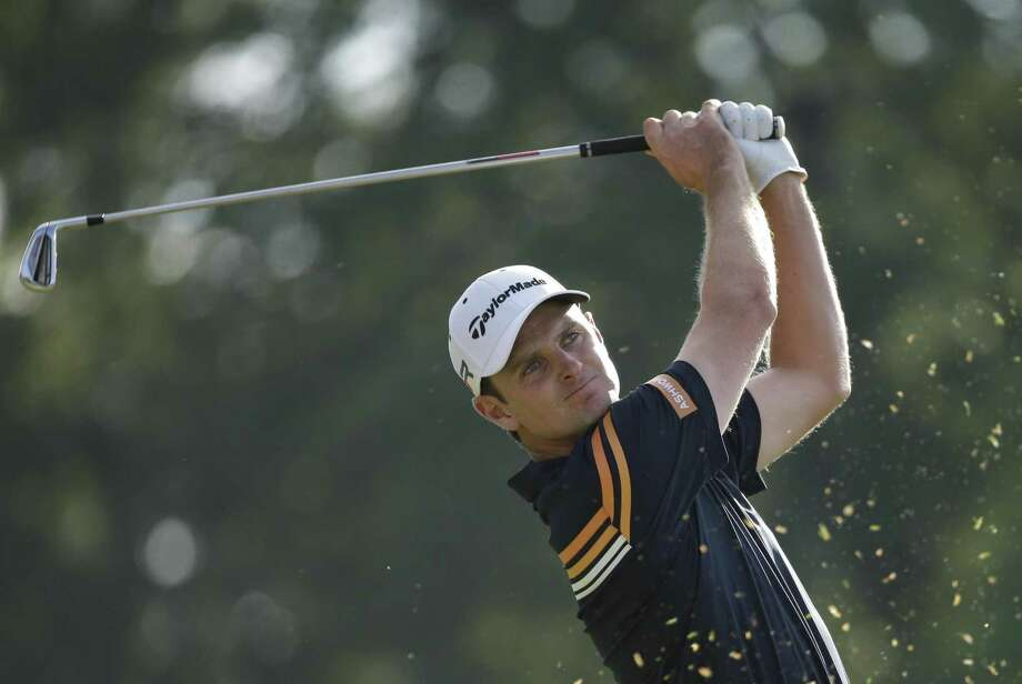 Justin Rose, of England, watches a tee shot during the second round of the U.S. Open golf tournament at Merion Golf Club, Friday, June 14, 2013, in Ardmore, Pa. (AP Photo/Gene J. Puskar) Photo: AP / AP