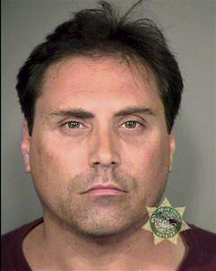 "This undated photo released by Multnomah County Sheriff's Office shows Kevin Purfield. Police say they have arrested a Portland man for harassing the families of victims of the mass shooting in Aurora, Colo., last July. Kevin Purfield is accused of emailing, calling and using social media to contact the victims' relatives. Investigators say the communications weren't threatening, but were annoying and included ""vile language."" (AP Photo/Multnomah County Sheriff's Office) Photo: AP / Multnomah County Sheriff's Office"