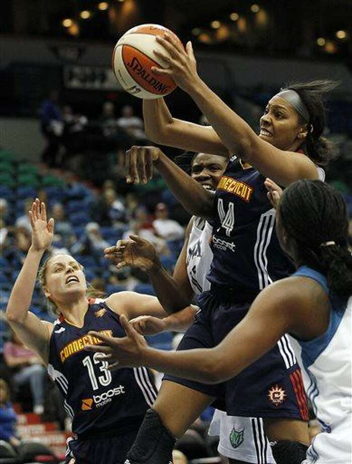 Connecticut Sun forward Ashley Walker (44) grabs a rebound out of reach from Minnesota Lynx forward Amber Harris (11) in the second half of a WNBA preseason women's basketball game, Tuesday, May 21, 2013, in Minneapolis. The Sun won 80-88. (AP Photo/Stacy Bengs) Photo: AP / FR170489 AP