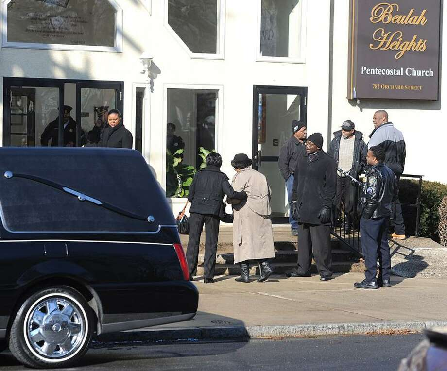 New Haven-- Mourners arrive at Beulah Heights Pentecostal Church the funeral of Lonnie Starr, the city's 2nd homicide victim of the year. Photo-Peter Casolino 2/6/13