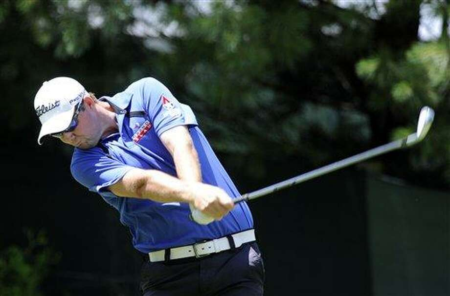 Marc Leishman, of Australia, hits a drive on the 10th hole during the final round of the Travelers Championship golf tournament in Cromwell, Conn., on Sunday, June 24, 2012. Leishman shot a final round 62 to win the tournament at 14-under par. (AP Photo/Fred Beckham) Photo: AP / FR153656 AP